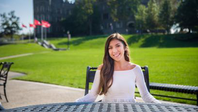 Jasmin Ramirez sits in front of Grey Towers Castle